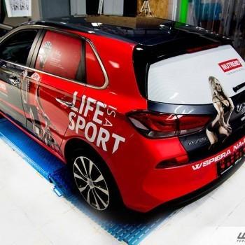 Oklejanie samochodów formowych dla firmy Nutrend